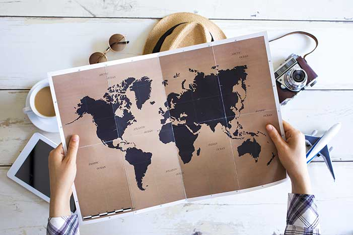 Person Holding Map of the World