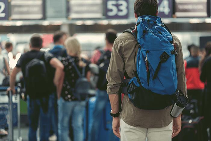 man waiting to board flight